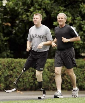 Bush jogs with double amputee